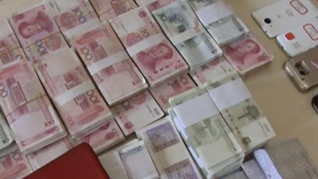 南宁侦破特大传销案,缴获成捆现金