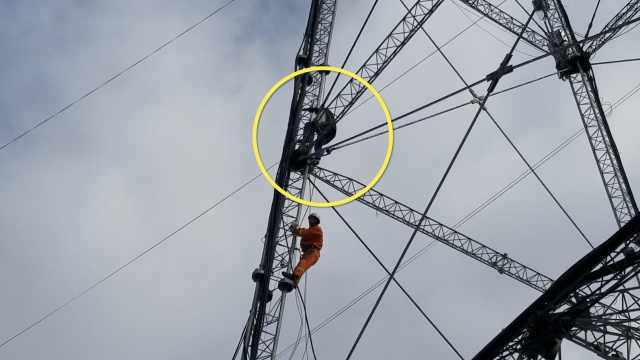 离婚男爬128米高塔,体力透支下不来