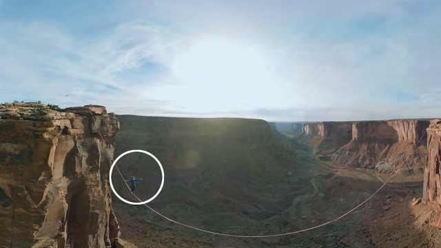 不要命!踩一根绳索就敢横穿山谷