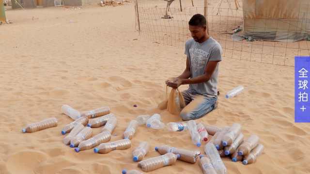 非洲沙漠里,他用塑料瓶盖难民营