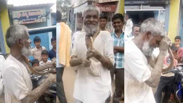 养老金被拖!印度老人带蛇进政府楼