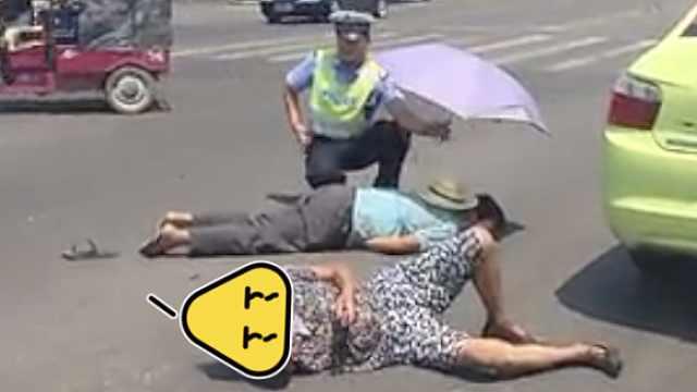 7旬夫妻遇车祸,交警烈日下撑伞守候