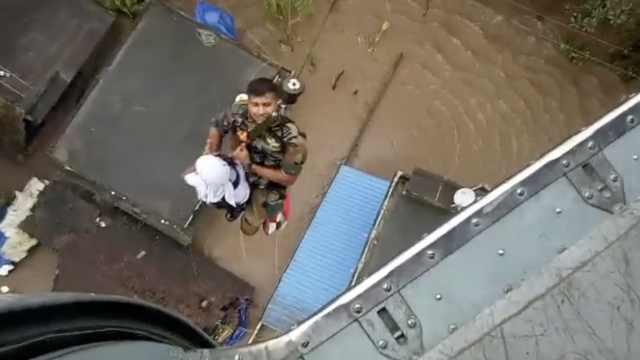 印洪灾已致164死,直升机参与救援