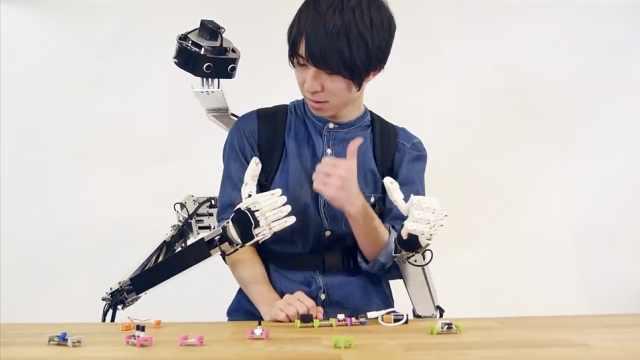 解放双手!日本研发机械手臂背包