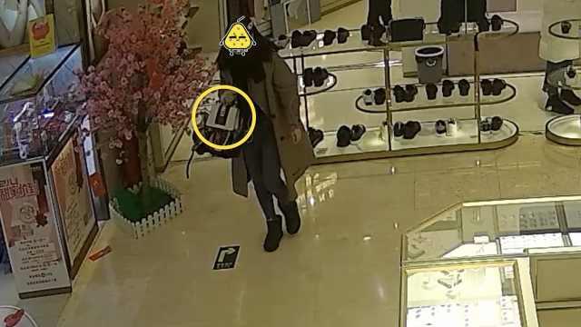 女子专柜偷价值1.8万Gucci包后自首