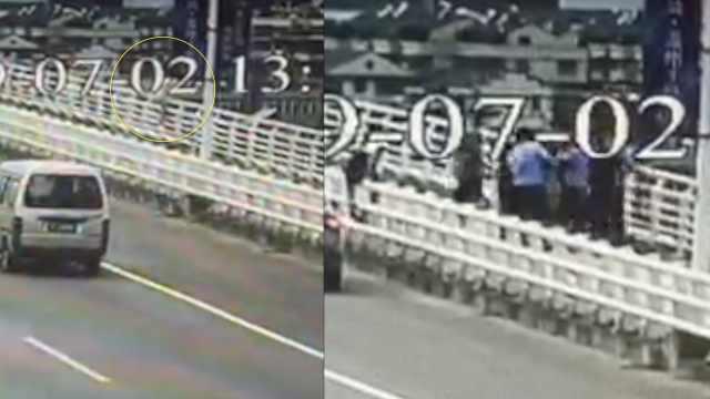 女子欲跳桥,十几人车流中跨栏营救