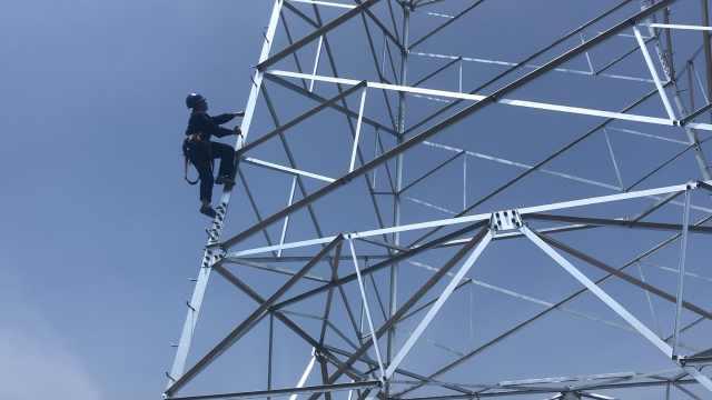 顶高温爬40米杆塔,研究生曾想大哭