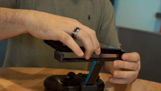 解锁Switch游戏新姿势!手机+支架,倒立也能玩