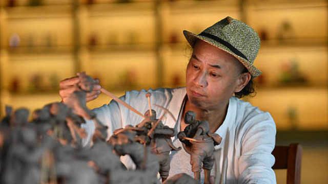 守艺人玩泥四十余年,巧手捏出南京民俗和水利建设系列作品