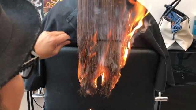 国外奇葩理发师,用打火机理发