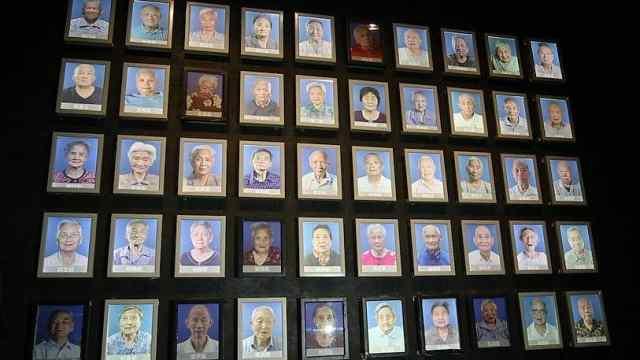 南京大屠杀幸存者墙的灯又熄了三盏