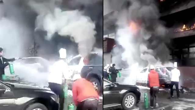 饭店火灾引燃门口小车,警民共扑灭