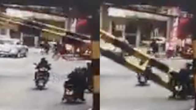 货车撞倒限高杆,2人被砸倒地不起