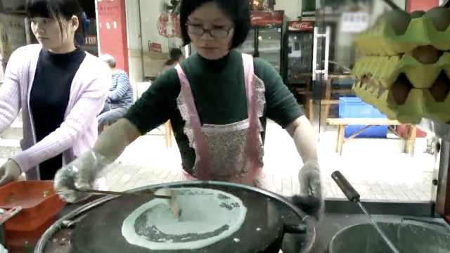 海归女在大学门口卖煎饼:从小梦想