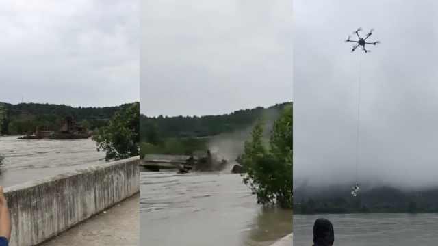 江水暴涨船失控撞毁大桥,400人被困