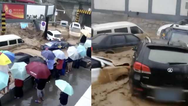 暴雨夜袭兰州致山洪,数十车被冲走