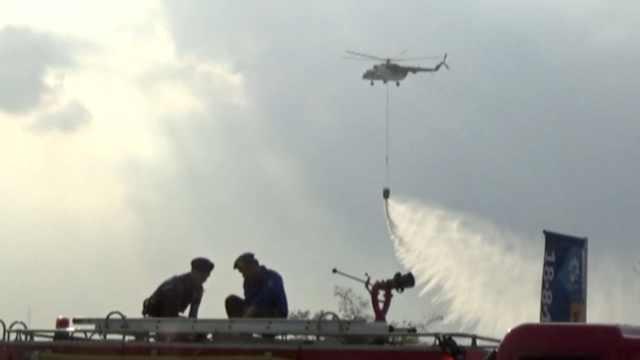 亚运村外千米处起火,5架直升机出动