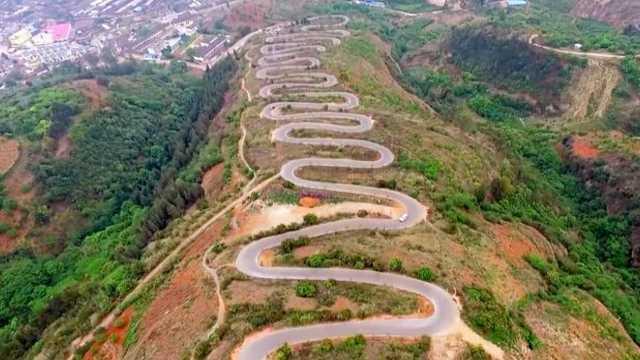 云南这条公路,为什么要建68个弯?