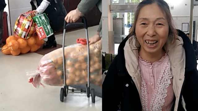大妈背200斤水果回家过年:分给亲人
