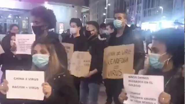 马德里青年游行呼吁不要歧视中国人