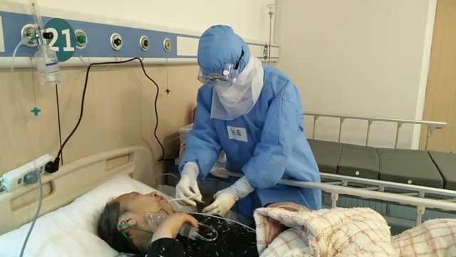 剪20年长发援鄂,她送首批患者出院