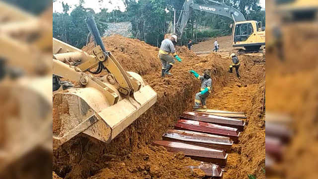 巴西因死亡人数激增采用集体墓葬,挖掘机推土掩埋