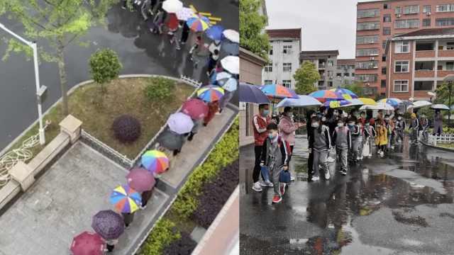"""30名老师架""""雨伞长廊""""护送学生:就怕学生淋湿感冒了"""