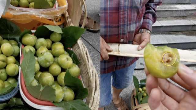 贵阳一路边摊卖低价蜂糖李,市民现场试吃,一