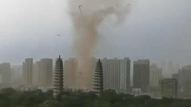 太原气象台回应双塔现旋风风柱:或为尘卷风,