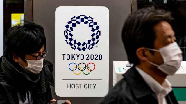 疫情严重!东京叫停圣火巡展,IOC委员:不能保证奥运能举行