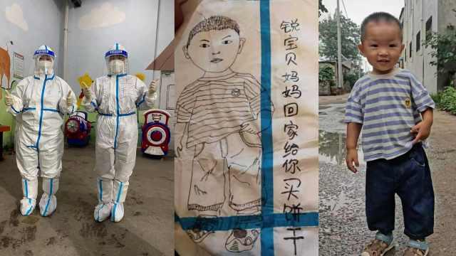 核酸检测员把儿子形象画防护服上:半个月没回家,很想他