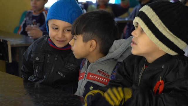 伊拉克学校恢复上课,但挣扎仍继续