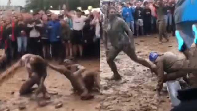 英国泥巴摔跤比赛:泥水里一决高下